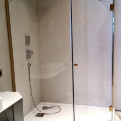 angular shower cabin, gold fittings, clear vision